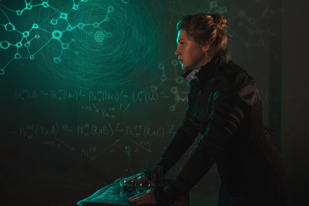 Scientist researcher on abstract background of schemes and formulas. History of science, great physical discoveries, radioactivity and structure of atom. Image in style of Marie Curie, concept