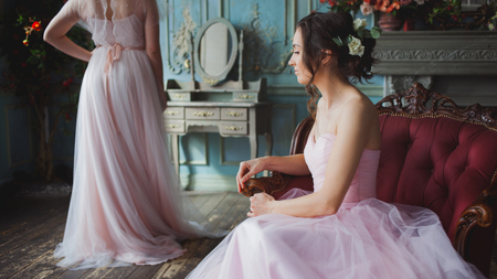 Bride and bridesmaids. Young beautiful women in pink wedding dresses, wedding fashion
