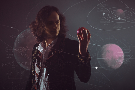 Physics the science of nature, the concept of studying the laws of nature. A young man in the image of Isaac Newton. With an Apple in hand, the concept of the laws of gravity.