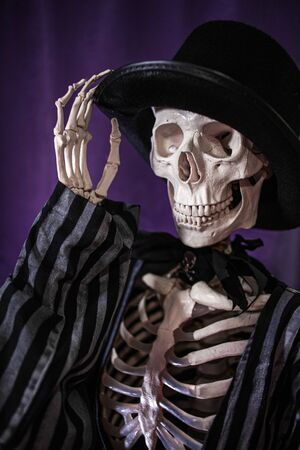 Halloween is coming soon, skeleton in striped suit and hat Banque d'images