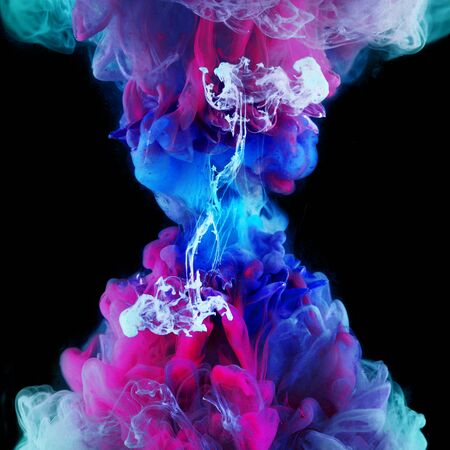 Explosion of color, concept. Splashes of colored ink in water, bright colors. Creative and color mix, abstract swirls of different colors on a black background