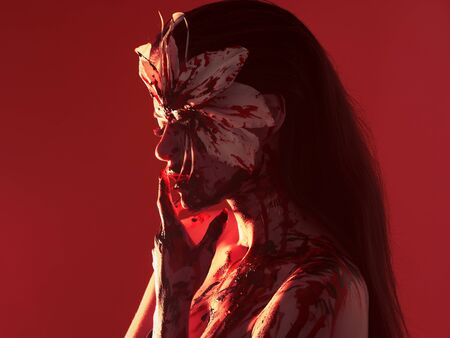 Blood Lily, scary and Halloween image. Beautiful young woman with a bloody flower, make-up and makeup.