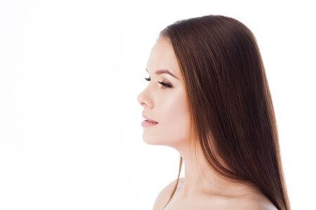 Portrait of a young beautiful woman with clean and healthy skin. Isolated on white. Side view, profile Stock Photo