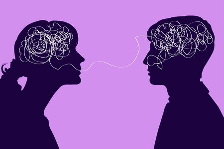 Dialogue between two people, confused thought concept. Communication between a man and a woman, problems in understanding. Two silhouettes with a tangled brain on a pink background