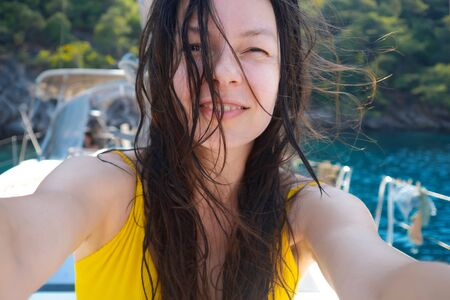 Happy young woman resting on the sea, portrait on the deck of a yacht. Boat trip Archivio Fotografico - 134838023