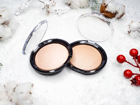 Christmas makeup and skin care. Winter makeup, new cosmetics, products for beauty and festive image. Powder, highlighter or Foundation