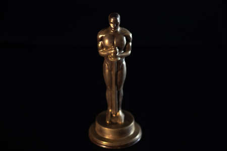 SAINT PETERSBURG, RUSSIA - MAY 8, 2020: Academy award statuette. Chocolate Oscars, movie awards, illustrative editorial