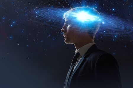 Dreamer, creative mind concept. A man with a galaxy in his head, complex human consciousness and psychology, inner space