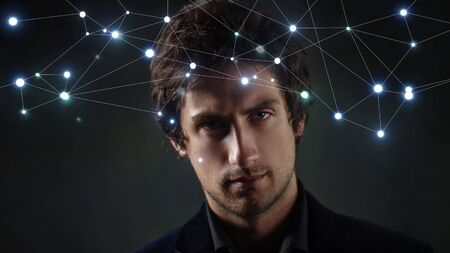Portrait of a serious young man and the structure of social connections or neural network, concept Archivio Fotografico