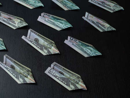 Paper planes made of dollar bills, usd cash flow concept. Inflation and problems in the economy, money flies away for spending.