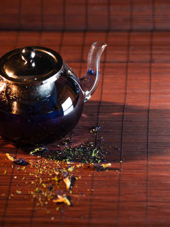 Blue Thai tea in a glass teapot. Freshly brewed tea, delicious and healthy hot drink. Hot drink on Mat, dark still life Stock fotó - 154841969