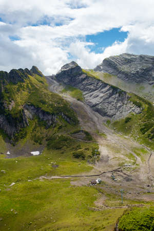 Epic mountain landscape. Beautiful natural terrain in the mountains, peaks and valleys, slope erosion.