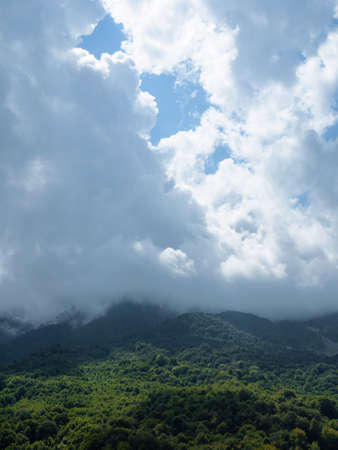 Beautiful mountain landscape. High-mountain massif, clouds over mountain peaks. 版權商用圖片