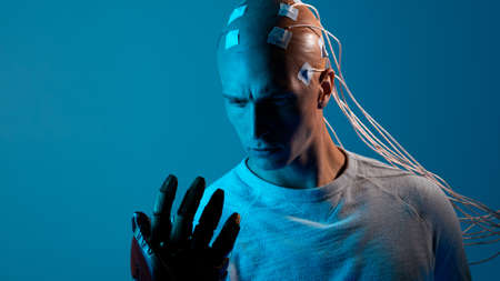 bald man with electrodes in his brain, a man of the future with technological additions, the brain is connected to virtual reality, additional opportunities for the brain, expansion of consciousness.