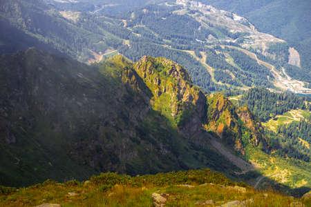 Beautiful mountain landscape. High-mountain massif, clouds over mountain peaks.