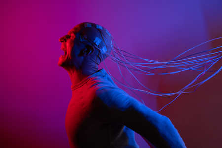 man with electrodes in his head screams in horror, a polygraph lie detector test, memory Erasure