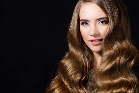 Luxurious golden curls, portrait of a young beautiful woman with beautiful hair, Stock fotó