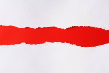 White paper with torn edges isolated with a bright red color paper background inside. Good paper texture Stock Photo
