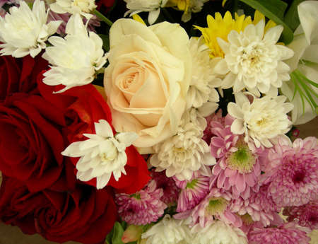callas: Bunch of flowers: roses, chrysanthemums, callas, lily. Stock Photo