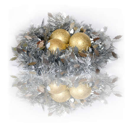 Silver nest with gold eggs. A New Years ornament. photo
