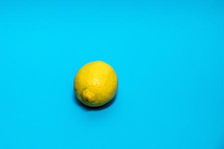 Yellow lemon against a blue background