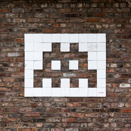 invader: A graffiti of a space invader from the famous video game