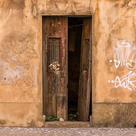 An old, broken and closed door in Portugal Editorial