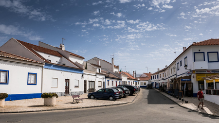 A street in Portugal leading through blue and white houses Editorial