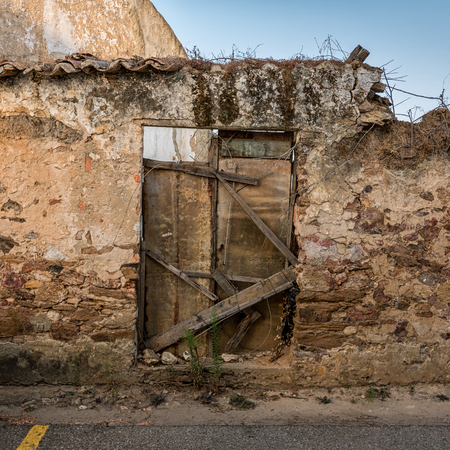 An old, broken and closed door in Portugal Stock Photo
