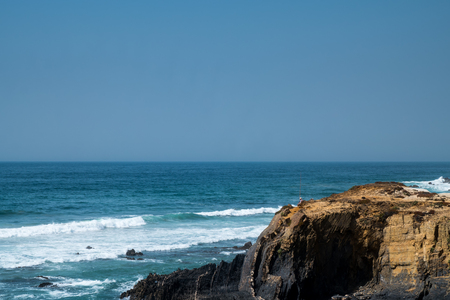 The coastline in portugal showing the ocean, cliffs, beach, and waves Stock Photo