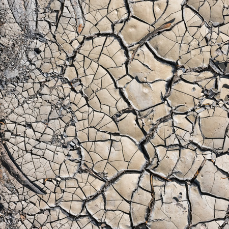 Cracked dry dirt on a road in Portugal