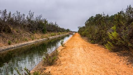 A stream running through a dry meadow in Portugal
