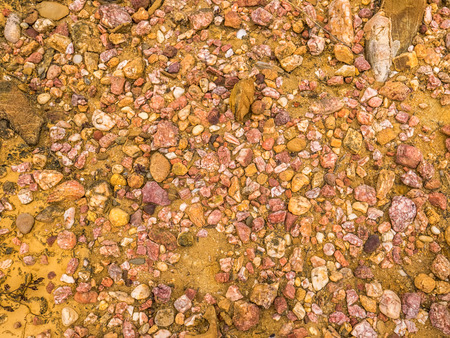 Pebbles on the ground making a perfect background Stock Photo