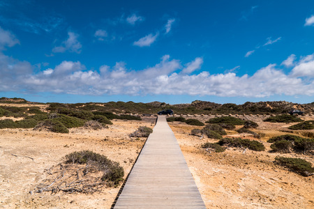 A wooden path on a beach in Portugal creating a symmetry Stock Photo