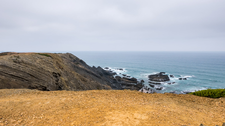 A beach between the cliffs in Portugal Stock Photo