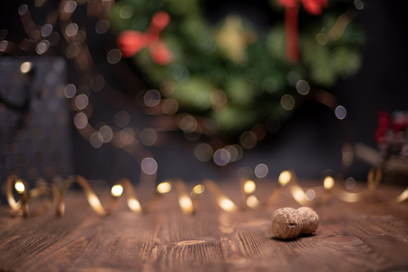 Smooth shady christmas and new year decoration background with round bokeh, golden ribbon and champagne cork