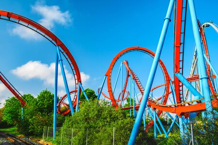 Salou, Catalonia/Spain - April 24, 2018: Attraction park Port Aventura. One of the biggest entertaining park in Europe. The bottom view on a roller coaster.
