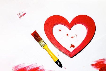The big red painted heart with a brush on a white paper background Imagens