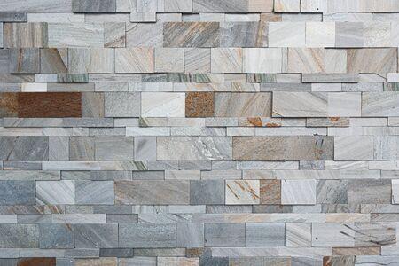 Diviser la texture du mur de marbre gris et marron artificiel moderne