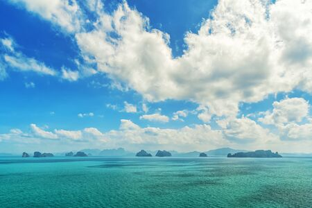 Tropical islands at ocean on the background of the fantastic cloudy sky Stockfoto - 136762669