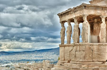 Athens, Greece - October 24, 2015: Erection, Acropolis, Athens, Temple Honoring Athena & Poseidon, this famous, ancient Greek temple features a porch with 6 caryatids