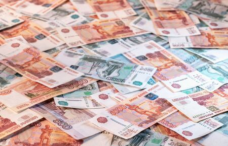 Background of banknotes of five and one thousand Russian rubles laying on a surface