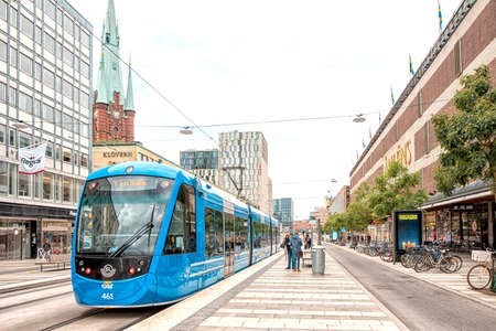 Stockholm/Sweden - August 8, 2019: Wiev on a blue new style tram on stop with people at T-Centrale station