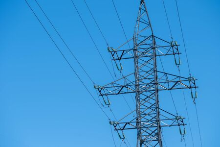 Power line towers against the background of the blue sky Stock Photo