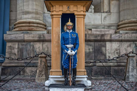 Stockholm, Sweden - August 3, 2019: Sweden Royal Guard in blue uniform protecting Royal Palace in Stockholm. Guard standing in the guard booth Redactioneel