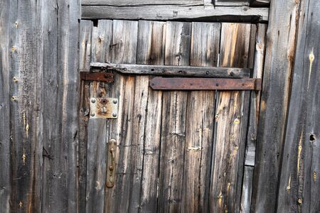 Old style vintage wooden door of country house