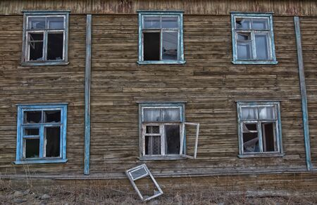 Old destroyed abandoned dirty raw wooden house with the broken out windows Stockfoto