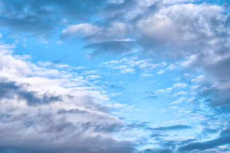 the bright blue cloudy sky in the summer midday Stockfoto