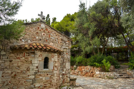 Charming old orthodox church of Church of Saint Demetrios Loumbardiaris. Located on Filopappou Hill. Greece. Europe.