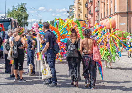Stockholm, Sweden - August 2, 2019: People on the street prepairing to a Pride parade.